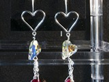 Sterling Silver Open Heart Earrings Swarovski Crystal Hearts and beads and dangling chains. Available in multiple colors: Siam, Amethyst, Peridot, Tanzanite, Sapphire, Astral Pink & More! Limited Quantities