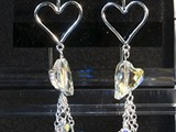 Lt. Sapphire Sterling Silver Open Heart Earrings Swarovski Crystal Hearts and beads and dangling chains. Available in multiple colors: Siam, Amethyst, Peridot, Tanzanite, Sapphire, Astral Pink & More! Limited Quantities