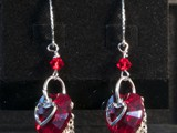 Sterling Silver & Swarovski Heart Earrings Swarovski Crystal Hearts and beads Dangling chains & open hearts Available in multiple colors: Siam, Amethyst, Peridot, Tanzanite, Sapphire, Astral Pink & More! Limited Quantities